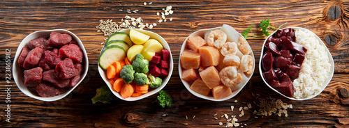 Leinwanddruck Bild Panorama banner with healthy pet food ingredients