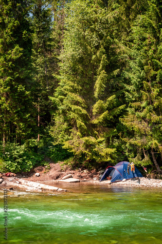 Foto Murales Breathtaking wild river and tent in Tatras mountains