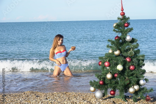 woman on christmas at the beach in the south with christmas tree - Christmas At The Beach