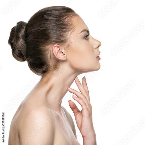 Foto Murales Beautiful woman cares for the skin neck