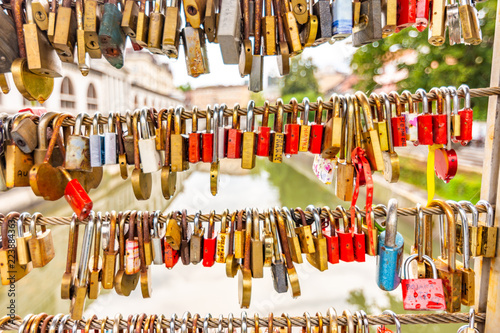 Leinwanddruck Bild Bridge in Ljubljana city, with locks as symbol of love. Romantic tradition in Slovenia capital.