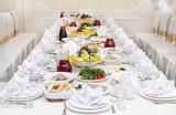 Served holiday table, cutlery, crockery, snacks - 223887754