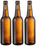 Three bottles of cold beer with big condensate drops.