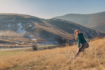 Young fit woman exercising on a mountain top © chrisgraphics