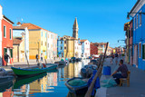 Scenery of canal and colorful vibrant fisherman village in Burano island, Venice, Italy