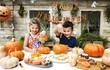Leinwanddruck Bild - Young kids carving Halloween jack-o'-lanterns