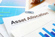 Asset allocation. Financial documents and pen on an office desk.