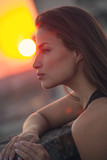 city girl portrait at top of building at sunset - 223975301