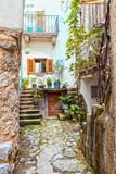 Narrow street with stones houses in Croatia, Vrbnik on Krk Island