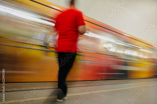 Fototapeta Train in motion in the subway as an abstract background