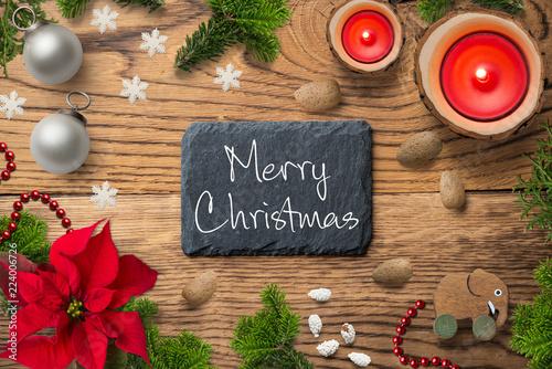 """Leinwanddruck Bild weihnachtlich Dekoration mit Nachricht """"Merry Christmas"""" auf Schieferplatte und rustikalem Holzuntergrund"""