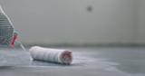 closeup applying protective coating on the concrete floor - 224007102