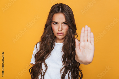 canvas print picture Portrait of a serious young girl with long brunette hair
