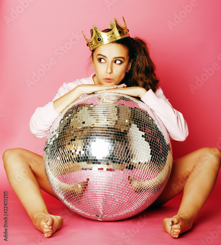 young cute disco girl on pink background with disco ball and cro - 224032115