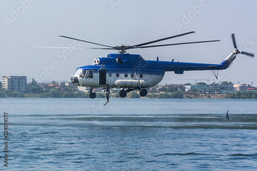 Fototapeta A Military Helicopter Deploying Assault Troops at an Airshow