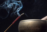 Tibetan singing bowl and incense sticks burning with smoke - 224058707