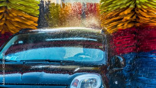 Fototapeta Car going through an automated car wash machine