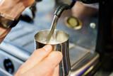 a coffee machine pours milk - 224071101
