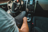 man check navigation on mobile in car - 224098337