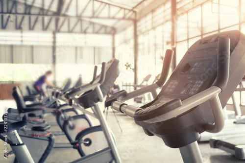 Sport gym trainning background, focus on bicycle machine equipment of training sport.