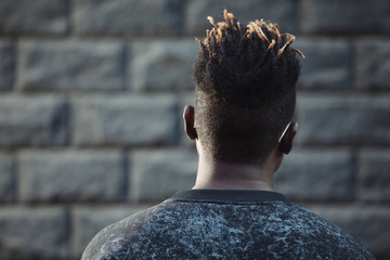 Nape, back view of african man head with dreadlocks hairstyle © antgor