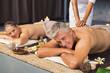 Leinwanddruck Bild Mature couple  in spa getting massage