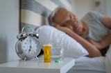 Man sleeping with medicines - 224113394