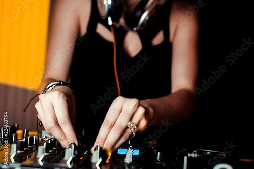 DJ playing at a party mixes music