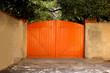orange wooden  car close gate