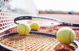 Tennis ball with racket on the tennis court. Sport, recreation concept - 224174353