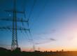 Leinwanddruck Bild - electricity pylons at sunset transporting clean renewable energy
