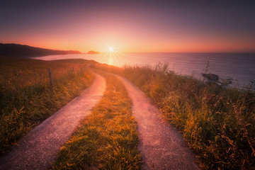 Path near the coast in Zarautz at sunset