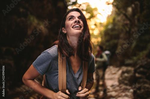 Beautiful woman enjoying hiking in nature - 224194306