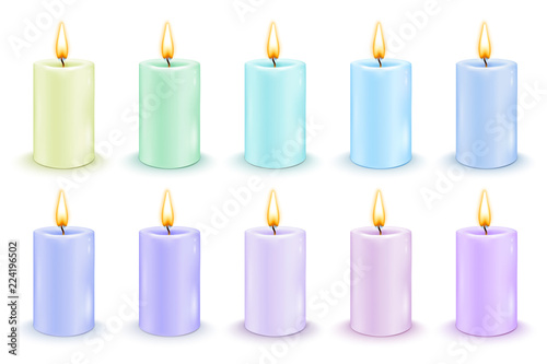 Set of color cylindrical candles with burning flames. © othernames