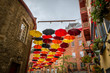 QUEBEC CITY, QUEBEC / CANADA - JULY 14 2018: Colorful umbrellas on city street