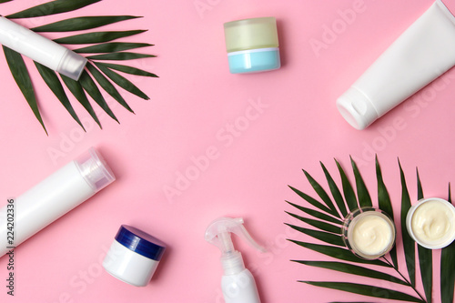 natural cosmetics and green leaf on a colored background top view. flatlay  - 224202336
