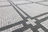 Granite cobblestoned pavement background with regular design - 224239353