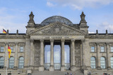 Portal of the Reichstag building (german government) with inscription Dem Deutschen Volke (to the German people) in Berlin the capital city of Germany, Europe, blue sky - 224242148