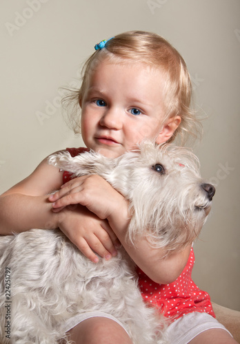 beautiful little blond girl and dog