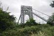 Washington bridge in New York. Mix of nature and man made. New York City. New Jersey. Bridge. Green. Gray. Cloudy sky