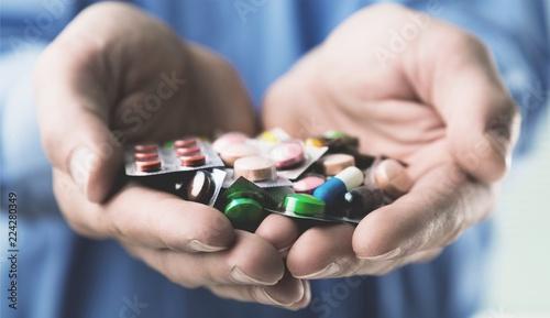 Leinwandbild Motiv Pills in human hands, close-up view