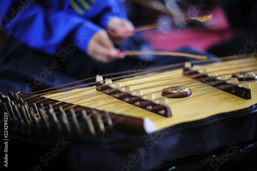 Young musicians playing dulcimer on concert - 224294329