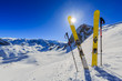 Leinwanddruck Bild - Ski in winter season, mountains and ski touring equipments on the top in sunny day in France, Alps above the clouds.