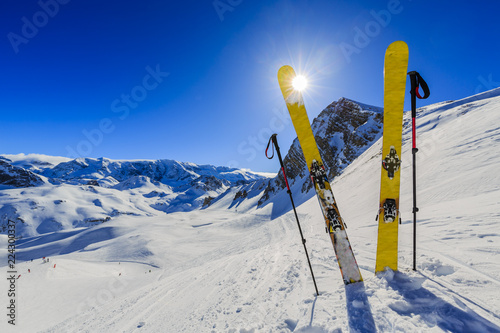 Leinwandbild Motiv Ski in winter season, mountains and ski touring equipments on the top in sunny day in France, Alps above the clouds.