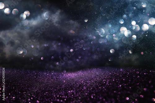 Leinwanddruck Bild glitter vintage lights background. black, blue, purple and silver. de-focused.