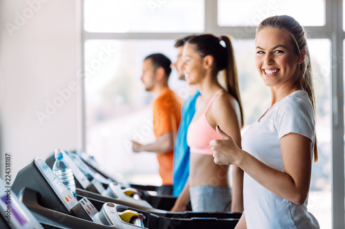 Poster Group of friends exercising on treadmill machine