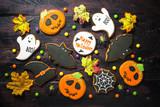 Halloween Gingerbread Cookies - pumpkin, ghosts, bat,  on woden