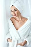Spa Skin Care. Beautiful Woman In Towel At Spa Beauty Salon