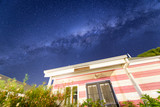 Pink house on a starry night with milky way - 224333955