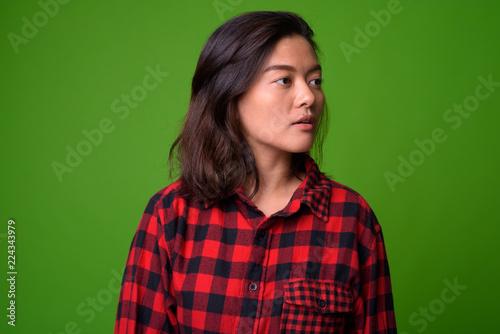 4f48e40e5b6 Young beautiful Asian hipster woman wearing red checkered shirt ...